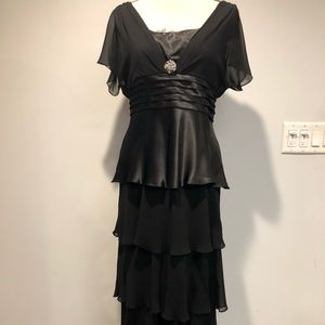 Black layered evening gown with accent brooch